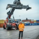 Henrik Akerstrom, CEO, in the terminal, in front of containermover